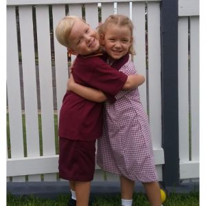 Claire and Owen in school uniform