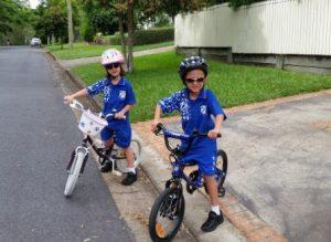 twins riding bikes