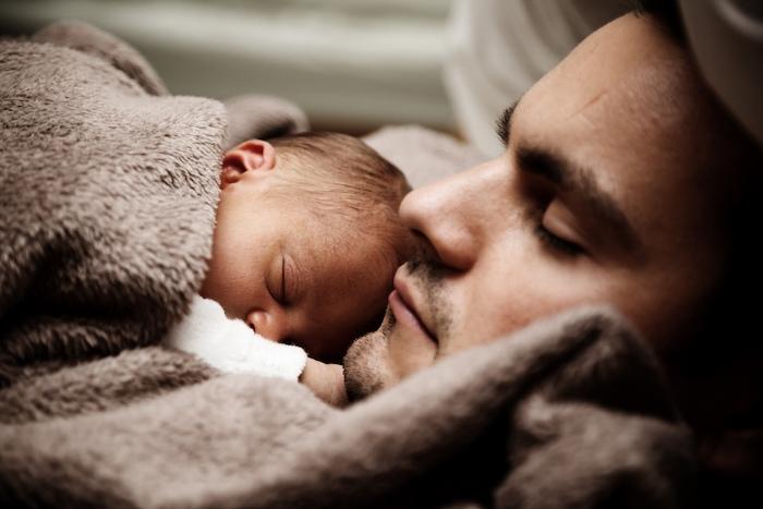 newborn snuggles with dad