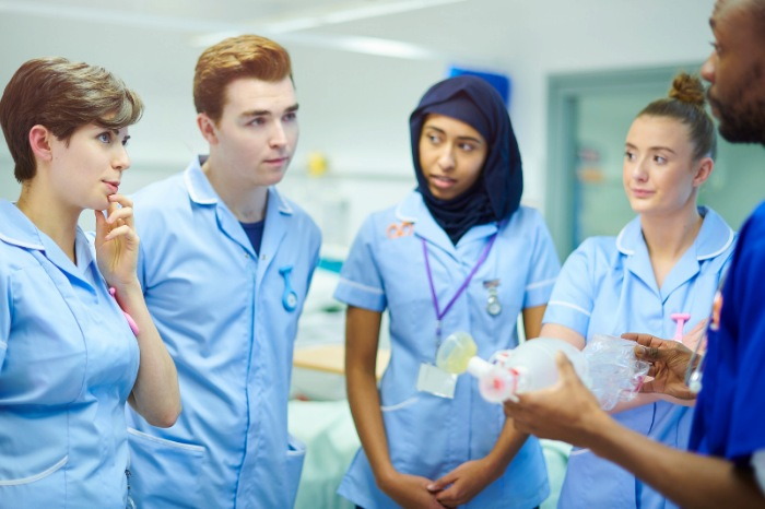 student midwife with twins or triplets